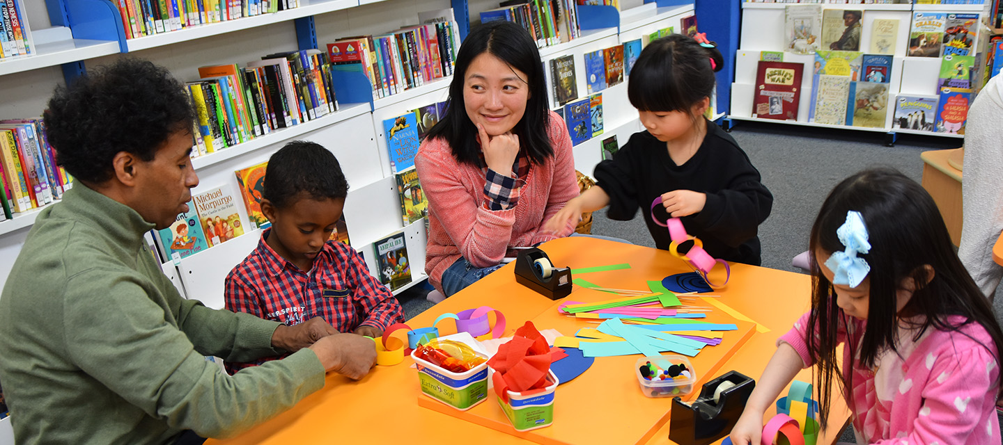 Children and their parents crafting in the library