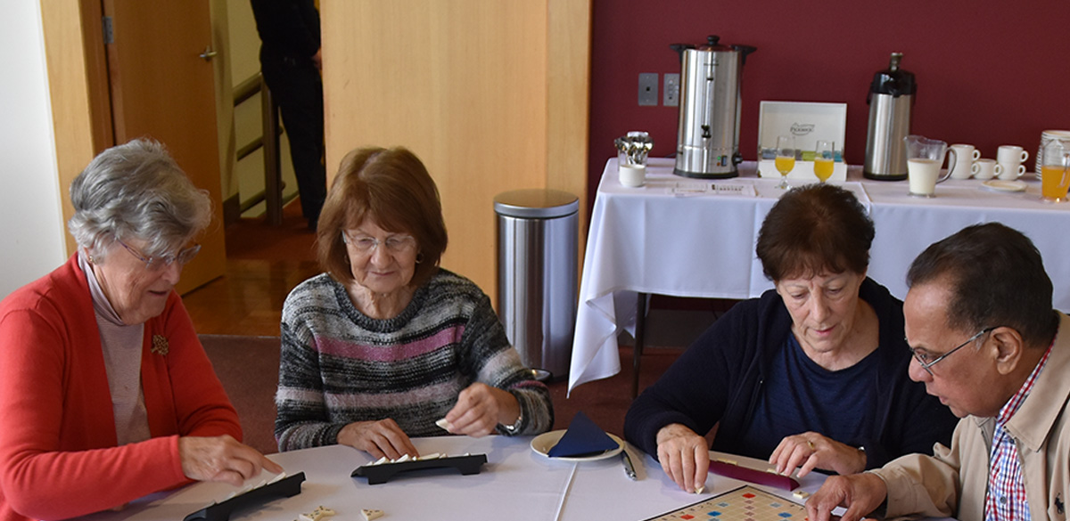 Seniors playing board games at Seniors' Event in Manningham Civic Centre