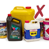 Photo of various used containers of motor oil, fluids, paint and solvents