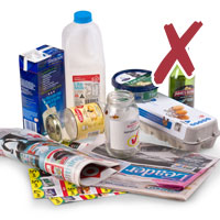 Photo of various recyclables such as milk cartons, newspapers and bottles with cross