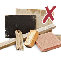 photo of various building material including concrete slabs, bricks, wood with tick
