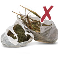 photo of garden waste in plastic bags