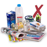 Photo of milk cartons, newspapers and egg cartons with cross