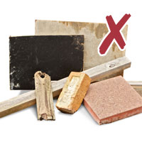 Photo of various building materials including wood, bricks and concrete with cross