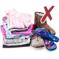 Photo of clothes linen folded, shoes and thongs with cross