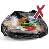 Photo of household garbage in a plastic bag with cross