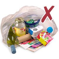 Photo of recyclable items in a plastic bag with cross