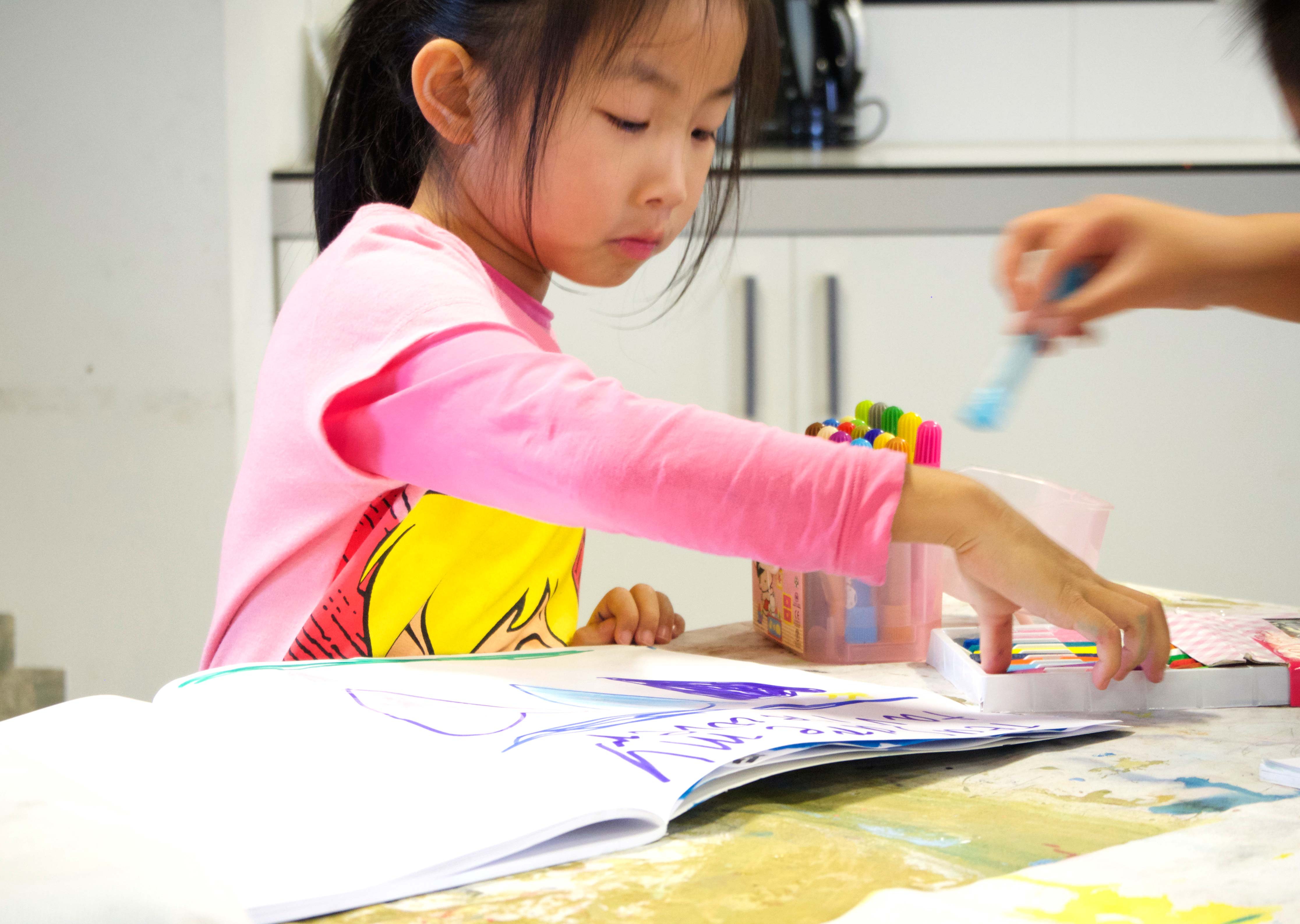 Manningham Art Studio girl with textas colouring in