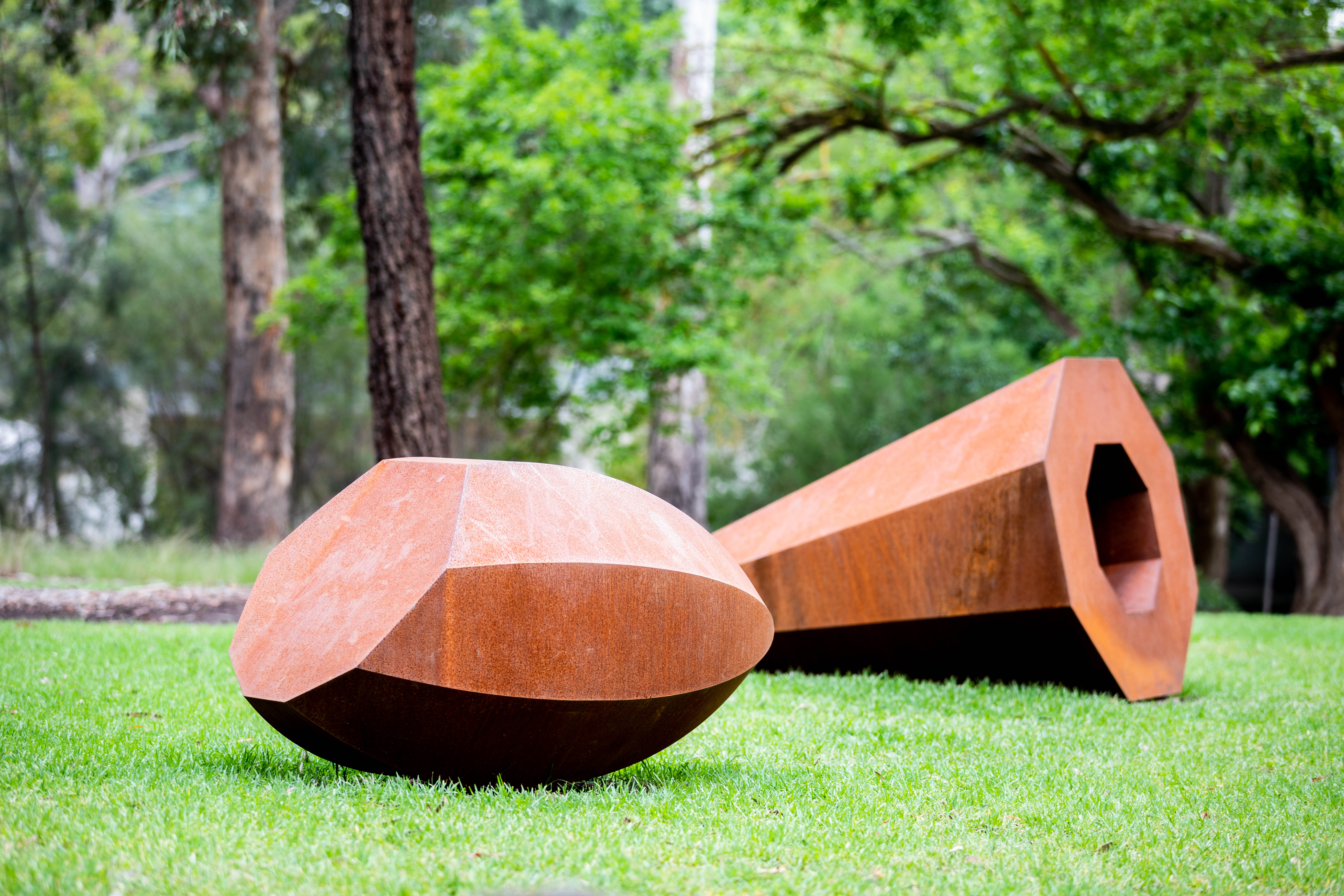 Rusted Metal Sculpture on Grass