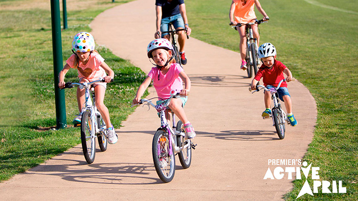 Family on bike riding in park