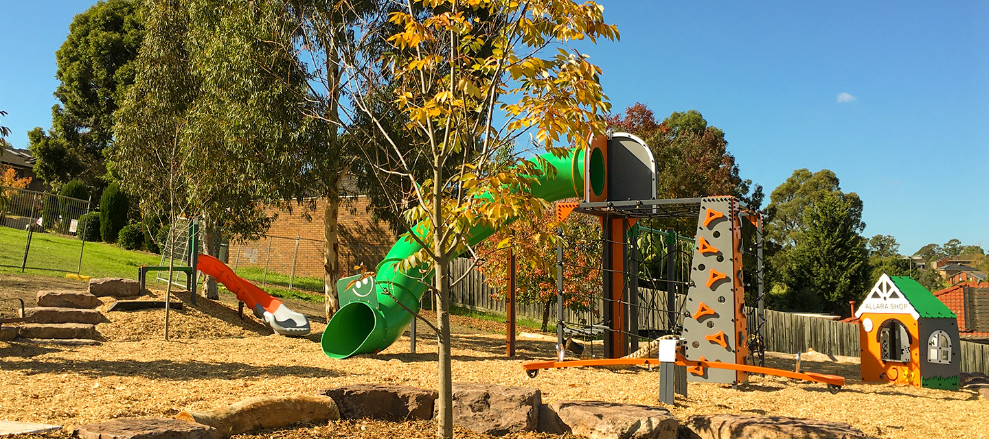 Newly planted tree and playground