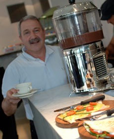 Businesss owner serving coffee