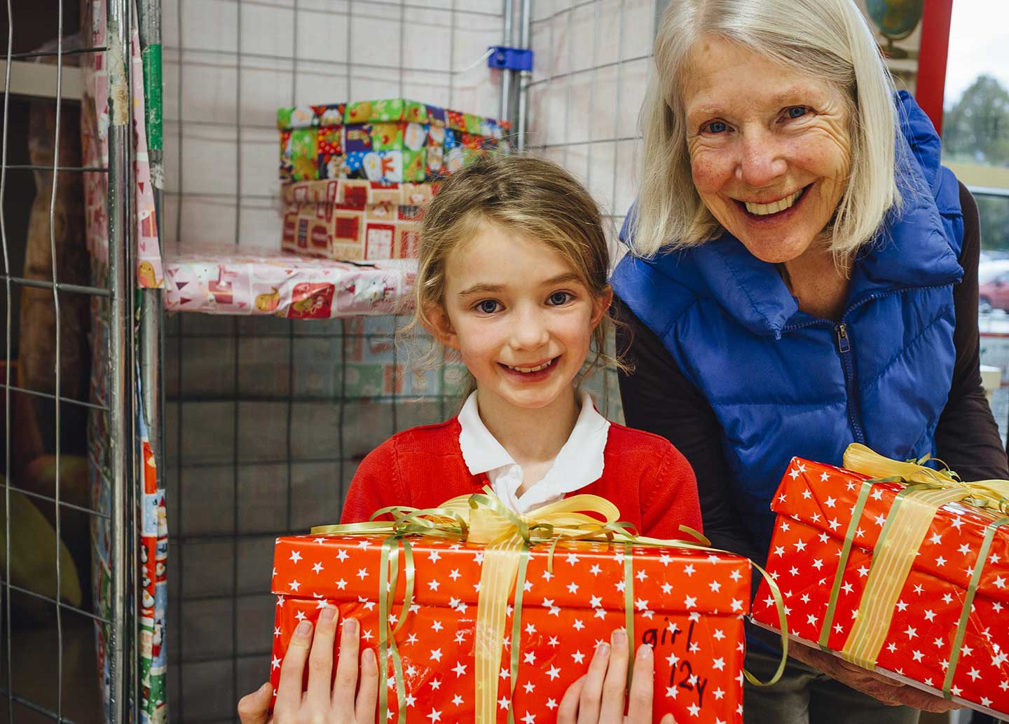 girl with grandmother holding christmas presents