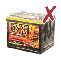 Picture of a used car battery with cross