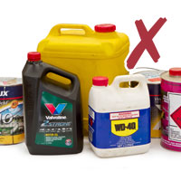 picture of chemicals containers motor oils and paints with cross