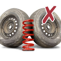 picture of red car spring and two truck tyres with cross