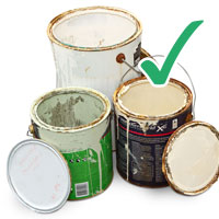 Picture of used empty paint tins with lids removed