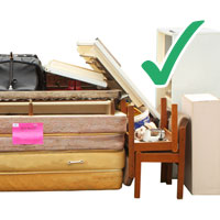 picture of various stacked funiture including chairs, bookshelves with tick