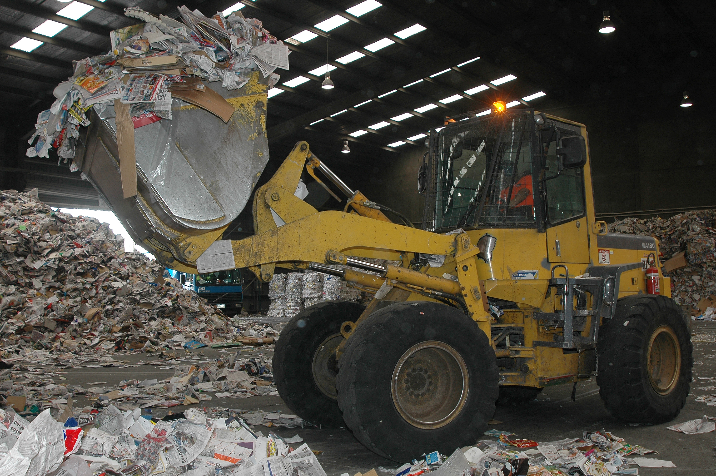 Photo of front loader sorting recyclables