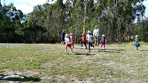photo of kids running on grass at Finns Reserve