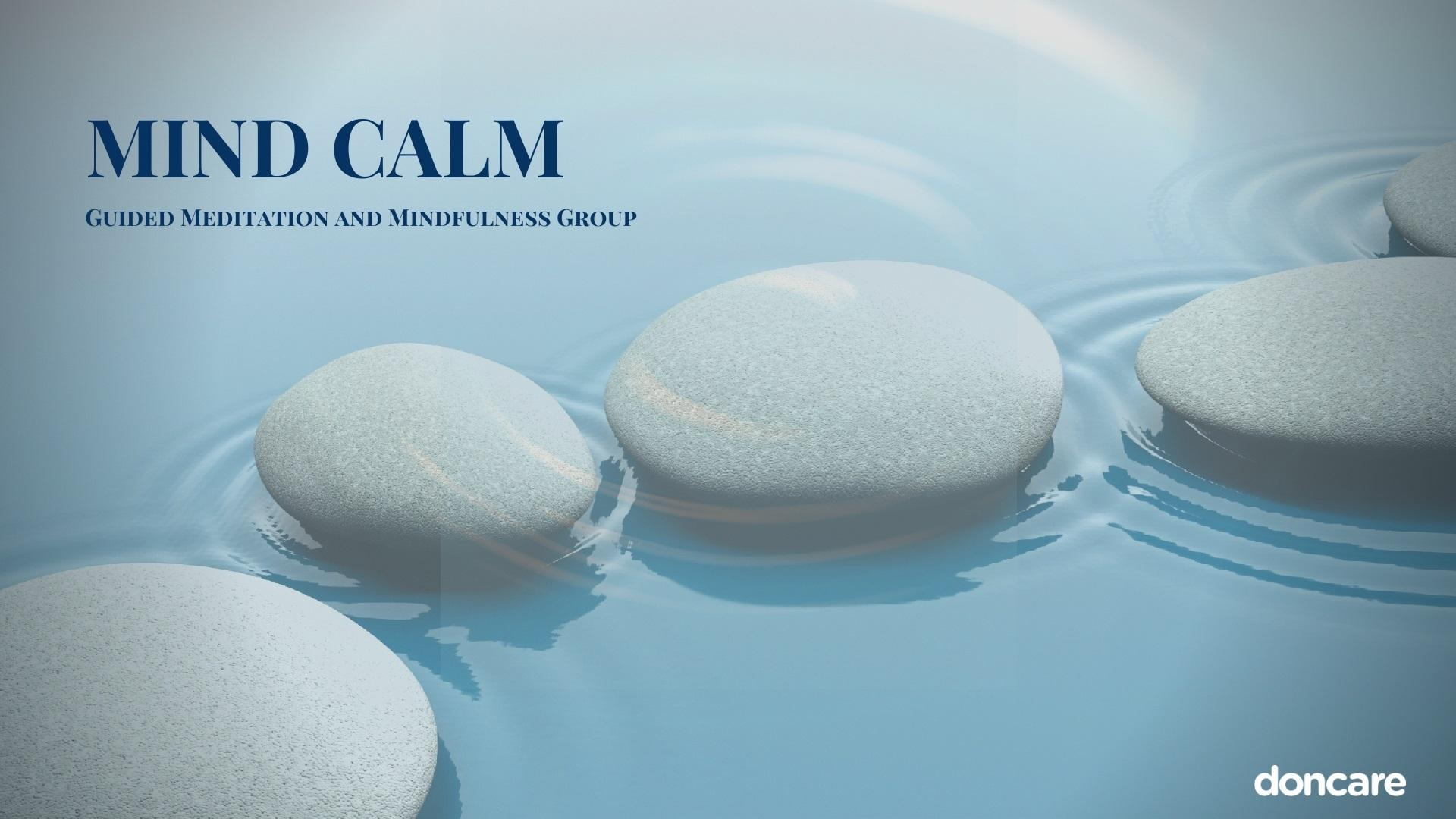 Pebbles sitting in water with Mind Calm text in left corner