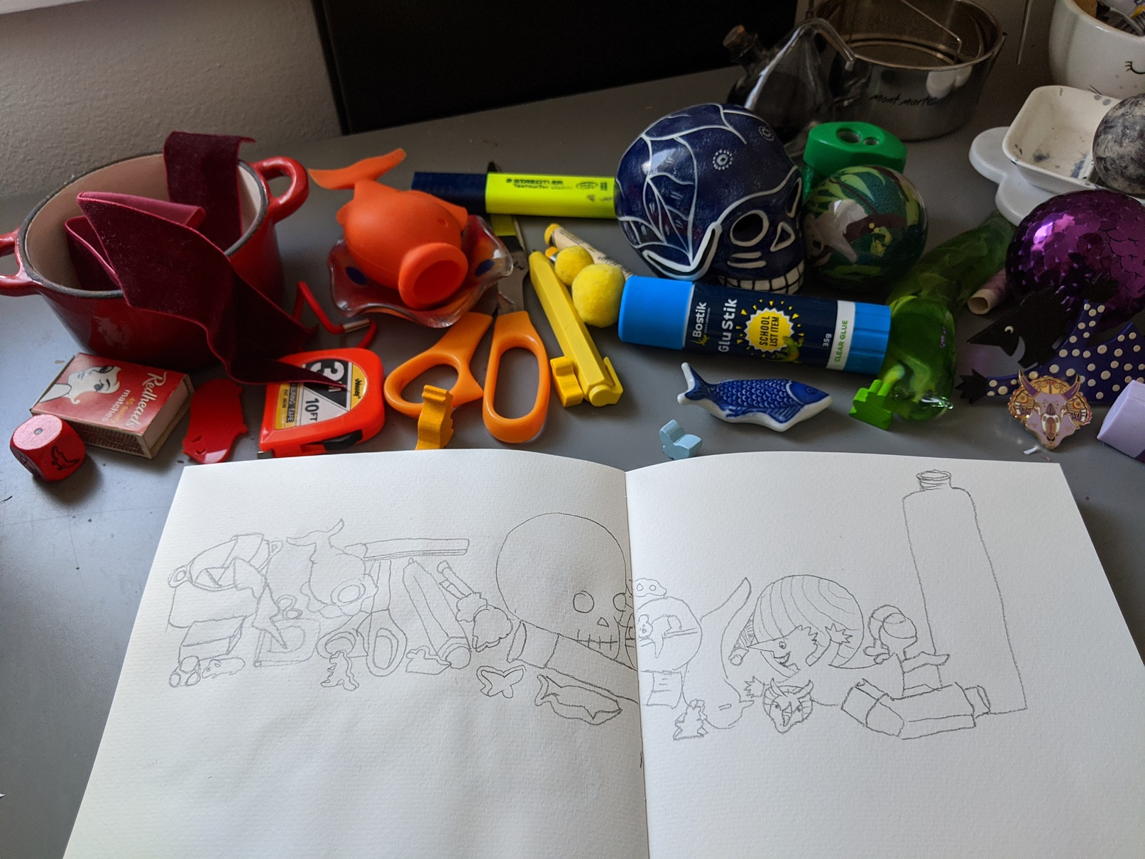 photograph of a collection of miscellaneous household objects with a sketch of the in the foreground