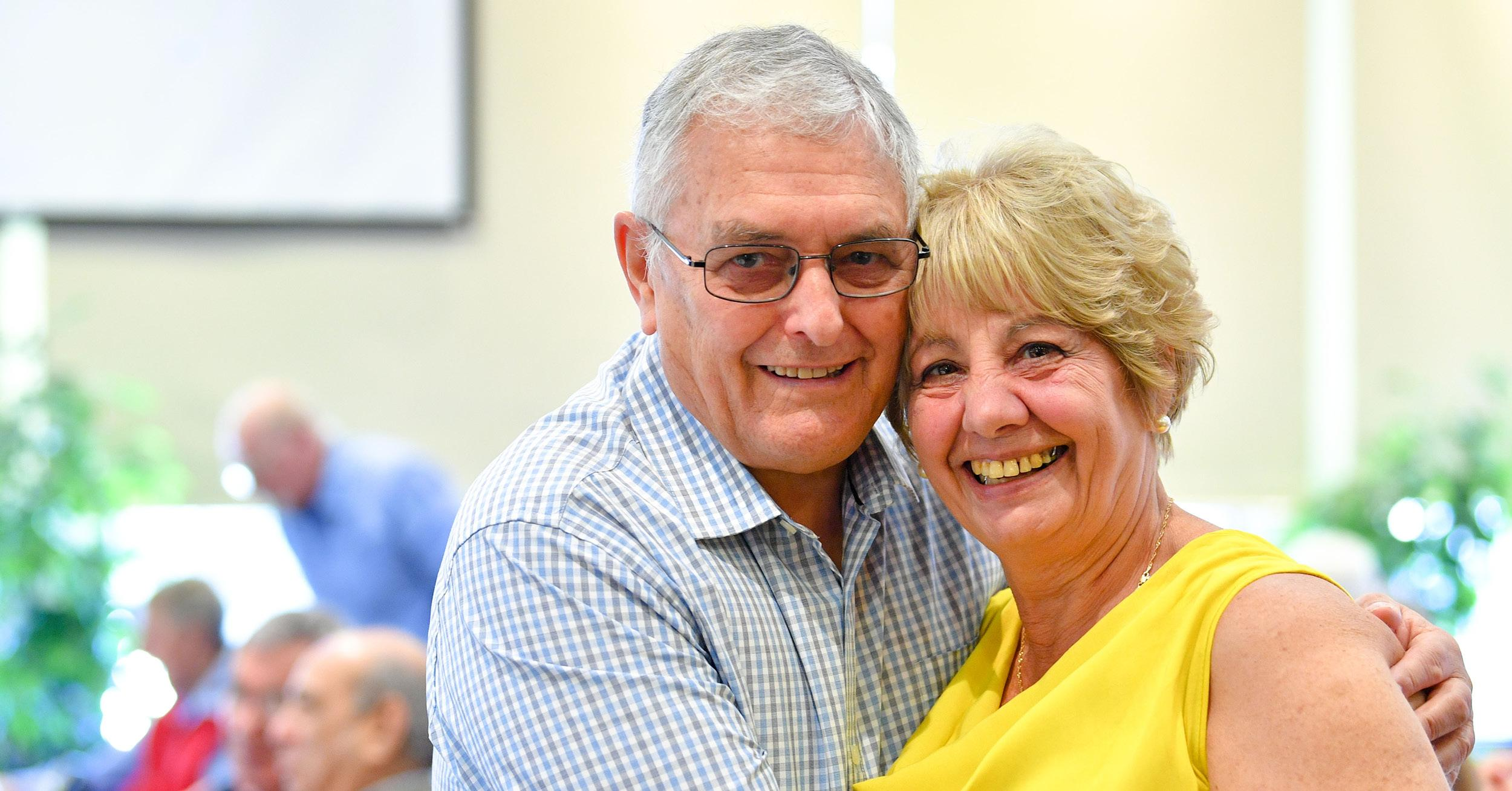 Senior couple hugging and posing for the camera