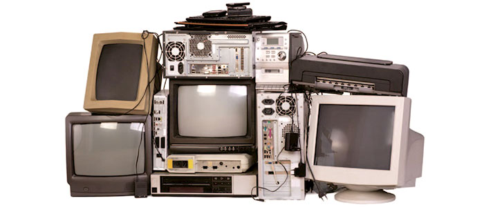 Old TV monitors, computer screens and other electronic waste piled up together