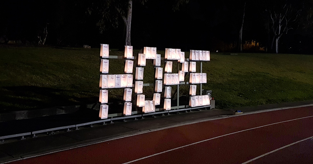 Candles in bags laid out to form the word hope