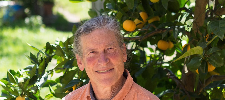 Portrait of David Holmgren in front of orange tree