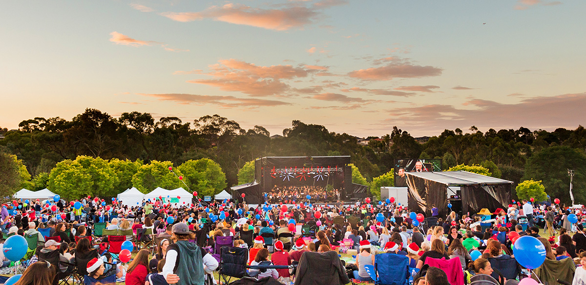 Crowd watching Carols at dusk